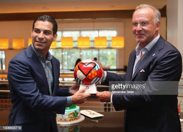 CEO of FC Bayern Muenchen KarlHeinz Rummenigge presents a soccer ball to the mayor of the city of Miami Francis Suarez during a cake cutting ceremony...