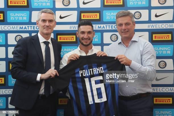 CEO of FC Internazionale Alessandro Antonello FC Internazionale new signing Matteo Politano and CEO of Rinascente Cocchini Pierluigi pose during a...