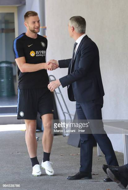CEO of FC Internazionale Alessandro Antonello shakes hands with Milan Skriniar during the FC Internazionale training session at the club's training...