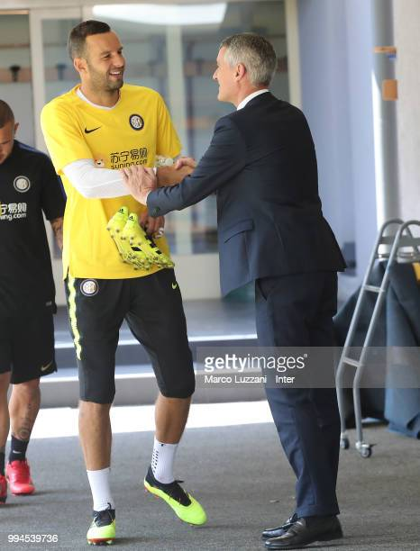 CEO of FC Internazionale Alessandro Antonello shakes hands with Samir Handanovic during the FC Internazionale training session at the club's training...