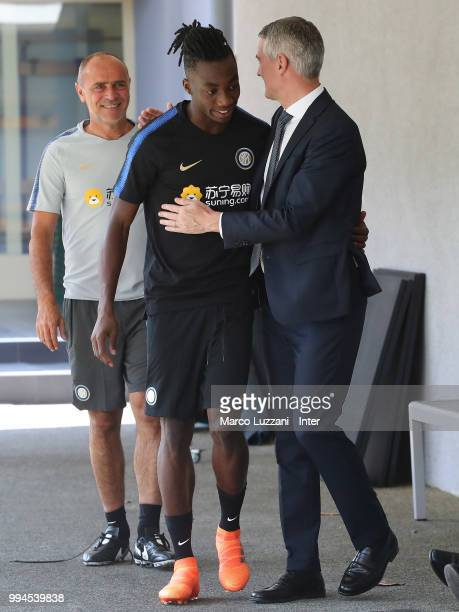 CEO of FC Internazionale Alessandro Antonello shakes hands with Yann Karamoh during the FC Internazionale training session at the club's training...