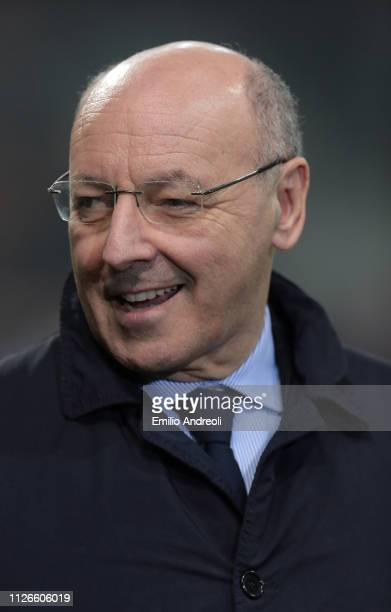 CEO of FC Internazionale Giuseppe Marotta smiles prior to the UEFA Europa League Round of 32 Second Leg match between FC Internazionale and SK Rapid...