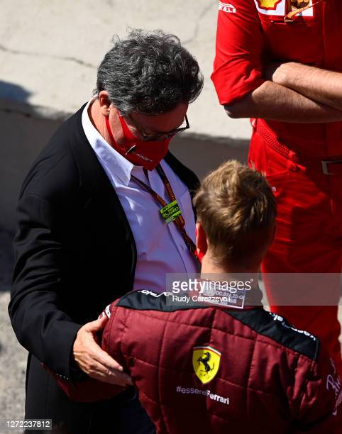 Of Ferrari Louis C Camilleri talks with Mick Schumacher of Germany before he performs a display run in the Ferrari F2004 before the F1 Grand Prix of...
