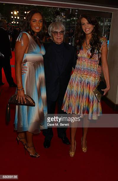 CEO of Formula One Adminstration Bernie Ecclestone and his daughters Tamara and Petra arrive at the European premiere of Batman Begins at the Odeon...