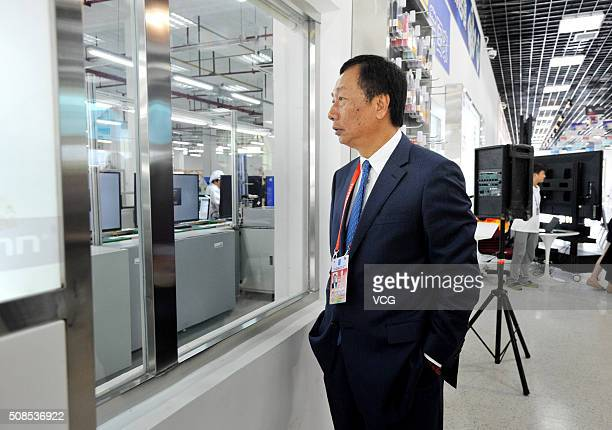 CEO of Foxconn Guo Taiming inspects the production line at Foxconn demonstration plant on July 10 2014 in Guiyang Guizhou province of China CEO of...