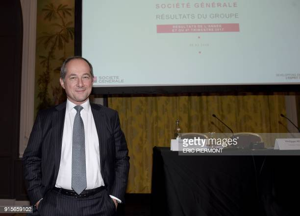 CEO of French bank Societe Generale Frederic Oudea poses for pictures as he arrives for the presentation of the group's 2017 results in Paris on...