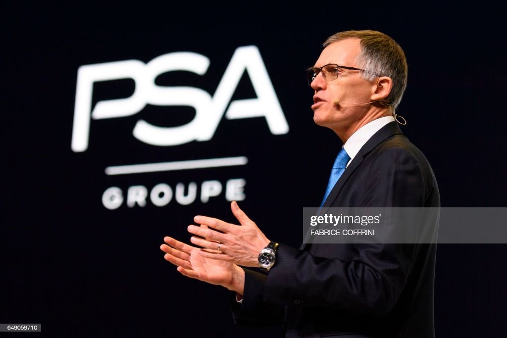 CEO of French carmaker PSA Groupe Carlos Tavares gestures at a press conference during the first press day of the Geneva International Motor Show on March 7, 2017 in Geneva. Europe's biggest annual car show kicks off in Geneva with luxury and crossover vehicles under the limelight, but with the emissions scandal still hanging over the industry. / AFP PHOTO / Fabrice COFFRINI