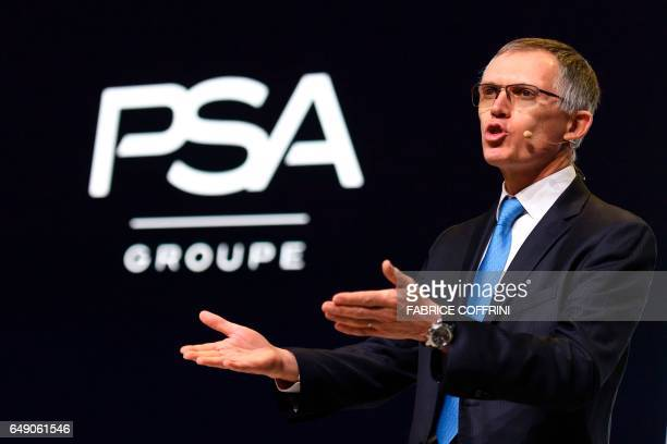 CEO of French carmaker PSA Groupe Carlos Tavares gestures at a press conference during the first press day of the Geneva International Motor Show on...