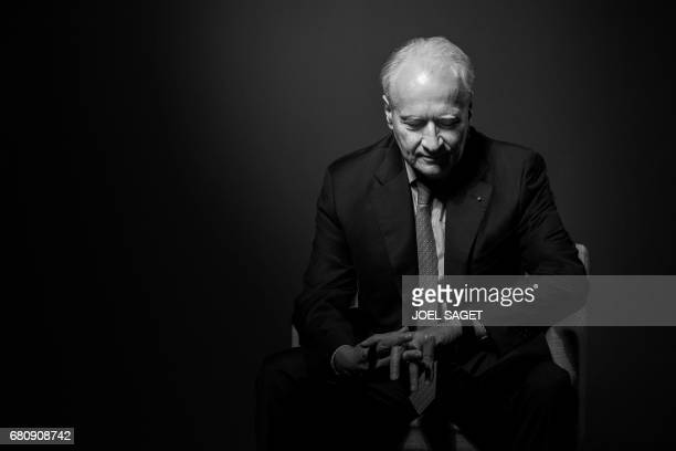 CEO of French concessions and construction company Vinci SA Xavier Huillard poses during a photo session in Paris on April 21 2017 / AFP PHOTO / JOEL...