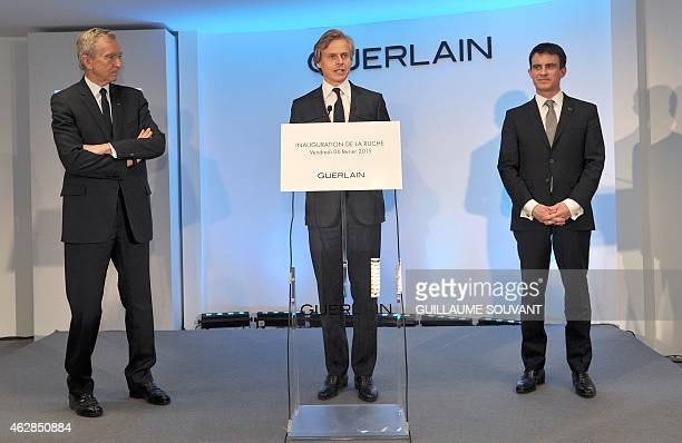 CEO of French Perfume House Guerlain Laurent Boillot gives a speech flanked by French luxury group LVMH Chairman and CEO Bernard Arnault and French...