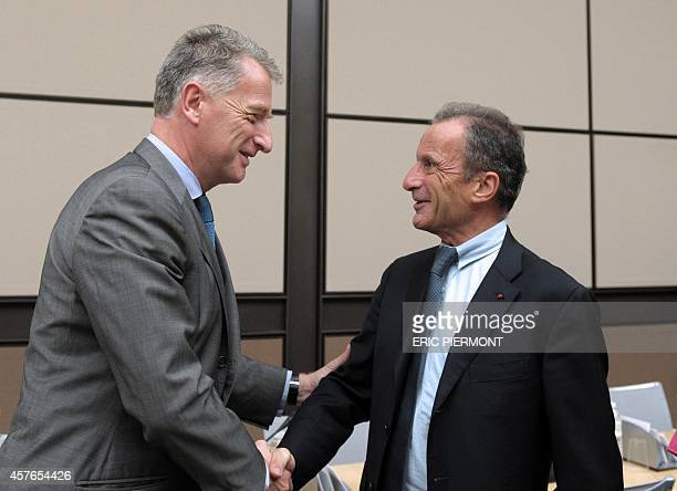 Of French state-owned electricity company EDF Henri Proglio shakes hands with Herve Gaymard , head of the French parliamentary investigating...