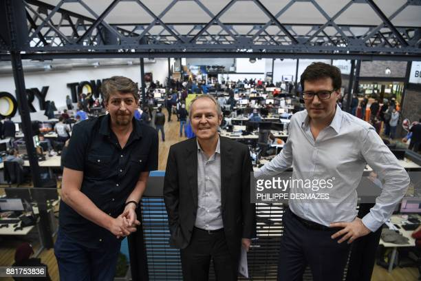 CEO of French video game publisher Ubisoft Yves Guillemot poses next to cofounders of French video game developer Ivory Tower Stephane Beley and...