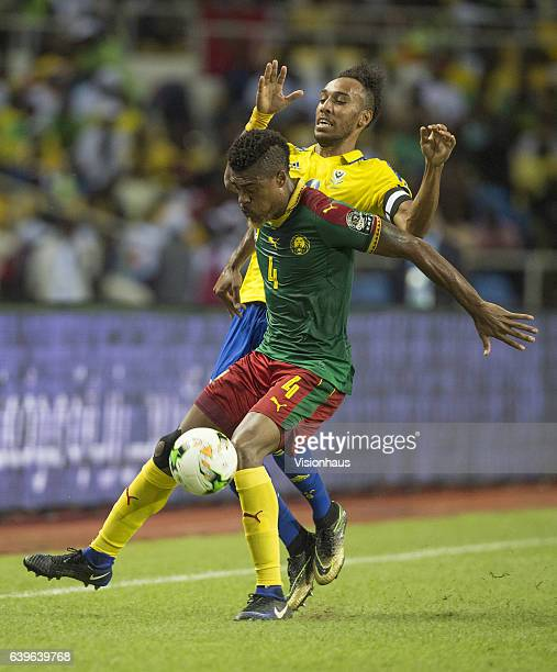 AUBAMEYANG of Gabon and ADOLPHE TEIKEU KAMGANG of Cameroon during the Group A match between Cameroon and Gabon at Stade de L'Amitie on January 22...