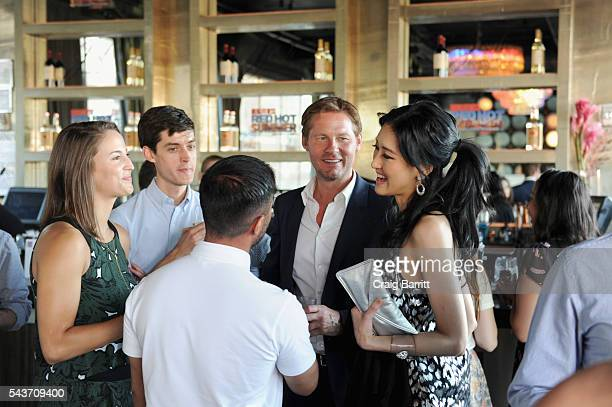 CEO of Galvanized Media David Zinczenko and TV personality Kelly Choi attend the MEN'S FITNESS Red Hot Summer Party on June 29 2016 in New York City