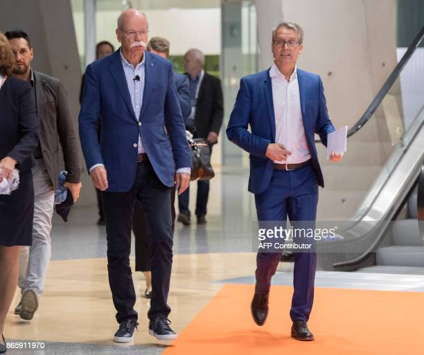 CEO of German Daimler AG and head of MercedesBenz cars Dieter Zetsche and Gabor Steingart publisher of German economy paper Handelsblatt arrive for...