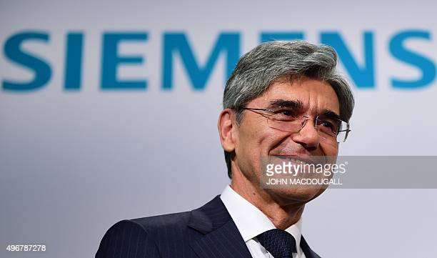 CEO of German industrial giant Siemens Joe Kaeser poses after addressing a press conference in Berlin on November 12 upon the announcement of the...