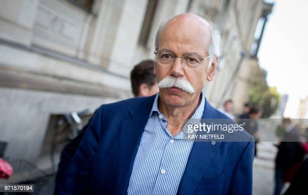 CEO of German luxury car manufacturer Daimler AG Dieter Zetsche leaves the German Ministry of Transport and Digital Infrastructure in Berlin on June...