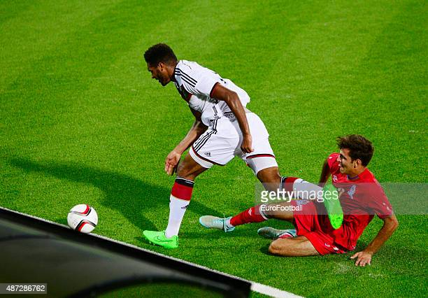of Germany and ILTER TASHKIN of Azerbaijan in action during the 2017 UEFA European U21 Championships Qualifier between Azerbaijan and Germany at...