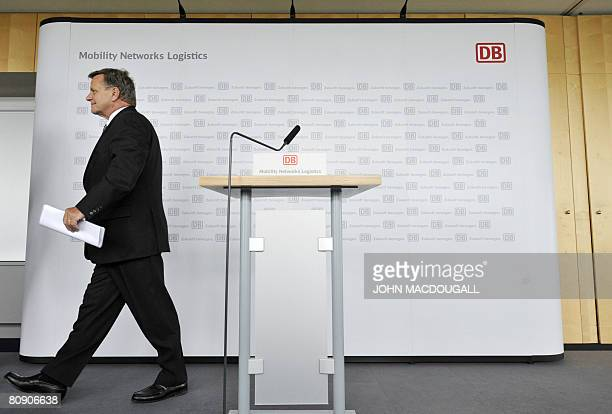 CEO of Germany's national railway company Deutsche Bahn Hartmut Mehdorn leaves after a press conference at the company's headquarters in Berlin on...