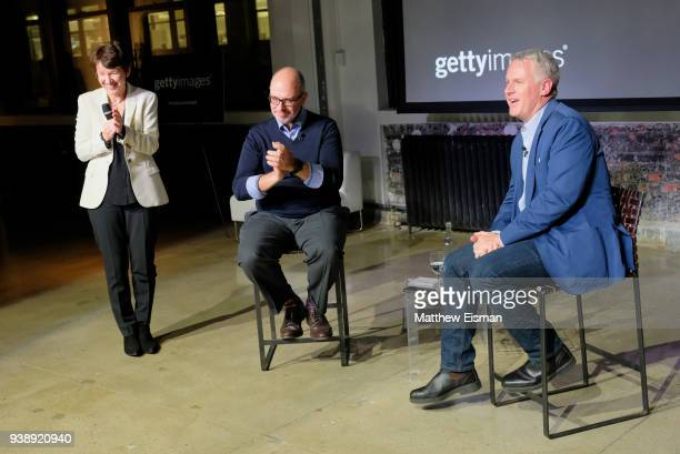CEO of Getty Images Dawn Airey Vice President of Editorial Pancho Bernasconi and Photographer John Moore speak onstage during the John Moore...