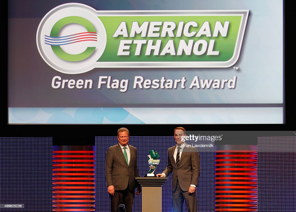 CEO of Growth Energy Tom Buis presents NASCAR Sprint Cup Series driver Kevin Harvick with the American Ethanol Green Flag Restart Award during the 2015 NASCAR NMPA Myers Brothers Awards Luncheon at Encore Las Vegas on December 3, 2015 in Las Vegas, Nevada.