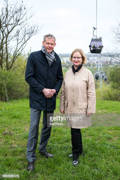 CEO of Gruen Berlin Christoph Schmidt and CEO of the IGA 2017 pose for a picture in front of the cable car during a press preview of the IGA 2017 in...