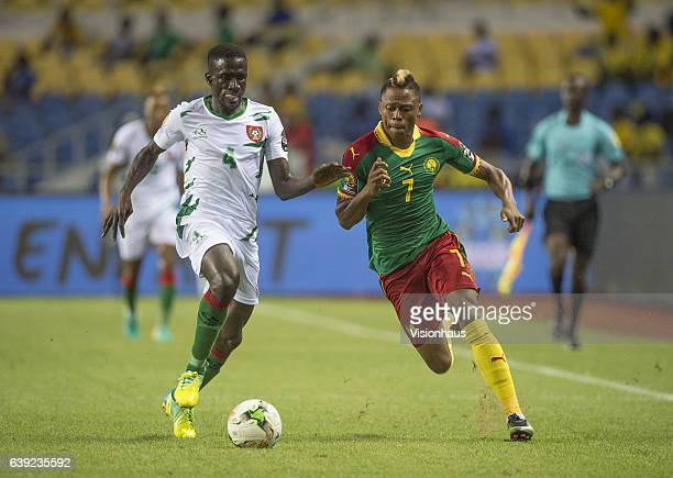 DABO of Guinea Bissau and CLINTON NJIE of Cameroon during the Group A match between Cameroon and Guinea Bissau at Stade de L'Amitie on January 18...
