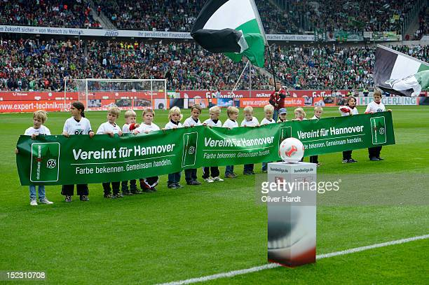 of Hannover and of Bremen battle for the ball during the 1 Bundesliga match between Hannover 96 and Werder Bremen at AWD Arena on September 15 2012...