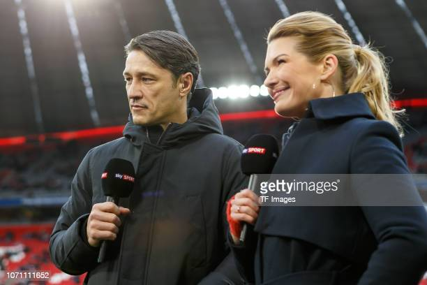 Of Head coach Niko Kovac of Bayern Muechen and Jessica Libbertz looks on during the Bundesliga match between FC Bayern Muenchen and 1. FC Nuernberg...