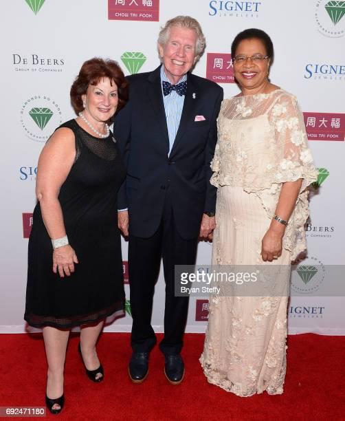 CEO of Helzberg Diamond Shops Inc Beryl Raff Paul Russell and humanitarian Graca Machel arrive at the Diamond Empowerment Fund's Diamonds Do Good...