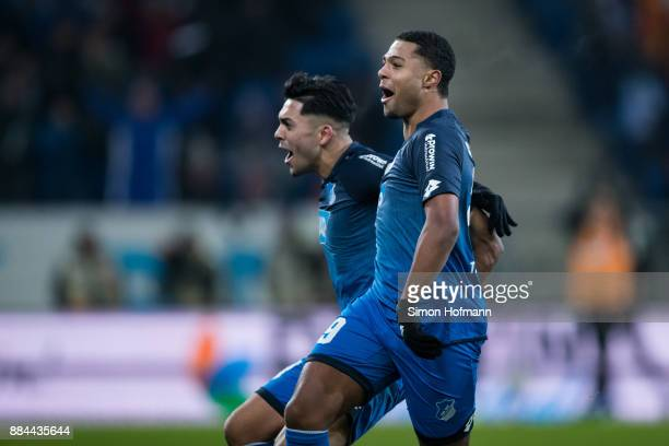 29 of Hoffenheim celebrates his team's third goal with team mate Nadiem Amiri during the Bundesliga match between TSG 1899 Hoffenheim and RB Leipzig...