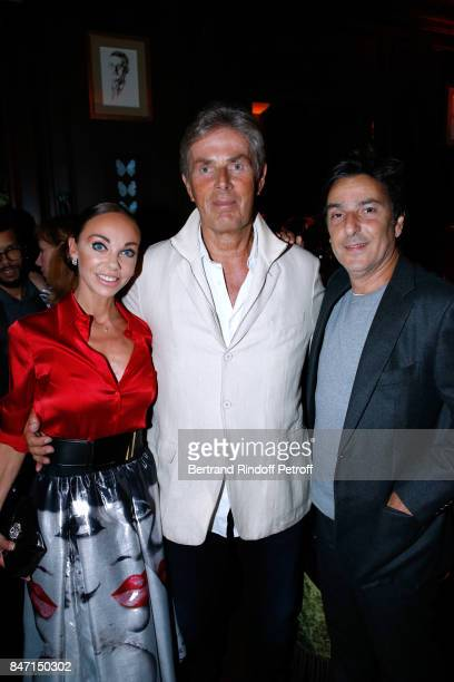 CEO of Hotel Barriere Dominique Desseigne standing between his companion Dancer Alexandra Cardinale and actor Yvan Attal attend the Reopening of the...