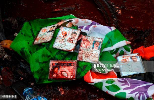 ID of injured people are seen above a flag of the proKurdish People's Democratic Party on the site of an explosion which injured several people...