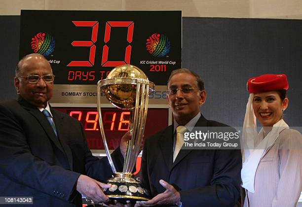CEO of International Cricket Council Haroon Logart presents the cricket world cup trophy to ICC president Sharad Pawar beginning the 30day countdown...