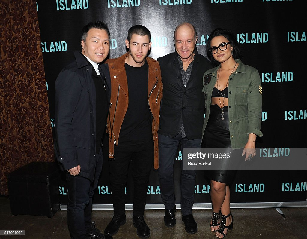 EVP/GM of Island Records Eric Wong, Island Records Recording Artist Nick Jonas, President - CEO of Island Records David Massey and Island Records Recording Artist Demi Lovato attend Island Records' 'Island Life' Second Anniversary Party At Avenue NYC at Avenue on March 22, 2016 in New York City.