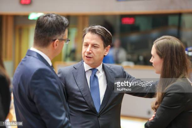 Of Italy Giuseppe Conte talks to Sanna Marin. Prime Minister of Finland Sanna Mirella Marin on the round table room during the second of the European...