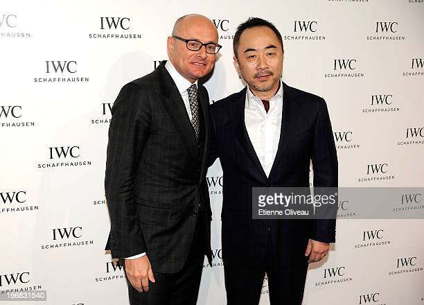 CEO of IWC Georges Kern and artist Wang Lu Yan pose for photographs during the IWC Flagship Boutique Opening on November 22 2012 in Beijing China