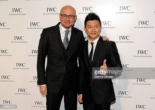 CEO of IWC Georges Kern and Olympic gold medalist Chen Yibing pose for photographs during the IWC Flagship Boutique Opening on November 22 2012 in...
