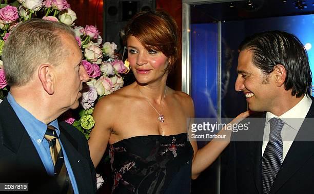 CEO of Jaguar Bob Dover and CEO of Steinmetz Nir Livnat talk to model Helene Christensen wearing the Monaco Rose 5960carat internally flawless pink...