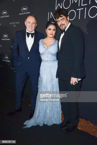 CEO of Kering FrancoisHenri Pinault Salma Hayek Pinault and Benicio del Toro attend the Kering Women In Motion dinner during the 71st annual Cannes...