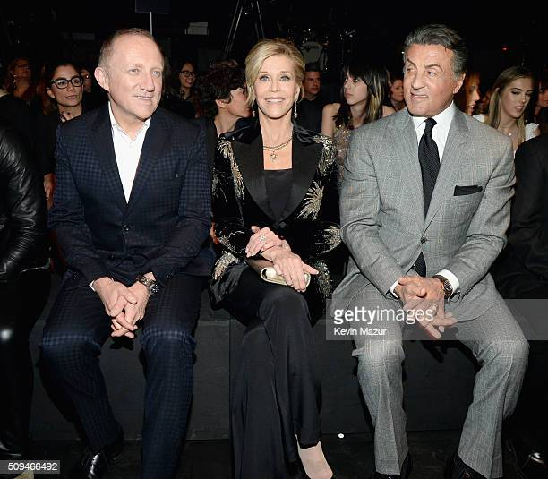 CEO of Kering FrançoisHenri Pinault and actors Jane Fonda in Saint Laurent by Hedi Slimane and Sylvester Stallone attend Saint Laurent at the...