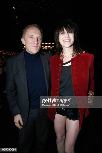 CEO of Kering Group FrancoisHenri Pinault and Charlotte Gainsbourg attend the Saint Laurent show as part of the Paris Fashion Week Womenswear...