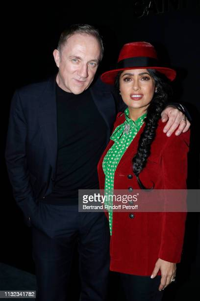CEO of Kering Group FrancoisHenri Pinault and his wife actress Salma Hayek attend the Saint Laurent show as part of the Paris Fashion Week Womenswear...