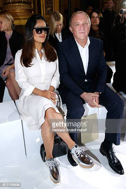 CEO of Kering Group FrancoisHenri Pinault and his wife actress Salma Hayek attend the Stella McCartney show as part of the Paris Fashion Week...
