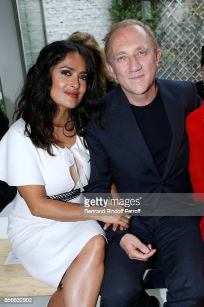CEO of Kering Group FrancoisHenri Pinault and his wife actress Salma Hayek attend the Giambattista Valli show as part of the Paris Fashion Week...