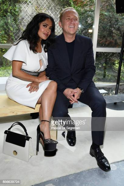 CEO of Kering Group FrancoisHenri Pinault and his wife actress Salma Hayek attends the Giambattista Valli show as part of the Paris Fashion Week...