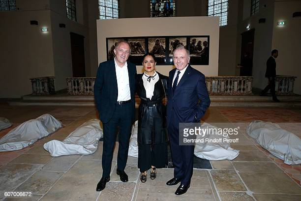 CEO of Kering Group FrancoisHenri Pinault his wife actress Salma Hayek and his father Francois Pinault attend the 4O Rue de Sevres Preview at the...