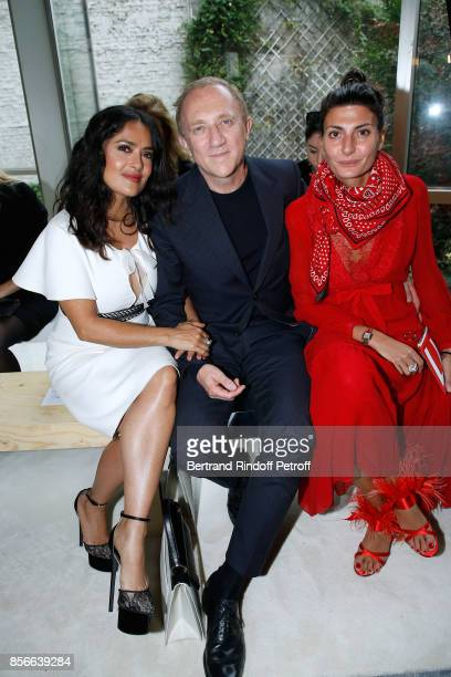 CEO of Kering Group FrancoisHenri Pinault sitting between his wife actress Salma Hayek and Giovanna Battaglia attend the Giambattista Valli show as...