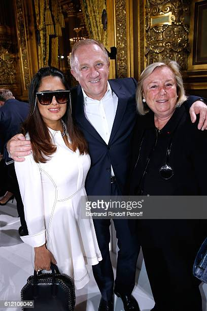 CEO of Kering Group FrancoisHenri Pinault standing between his wife Salma Hayek and his mother Maryvonne Pinault attend the Stella McCartney show as...