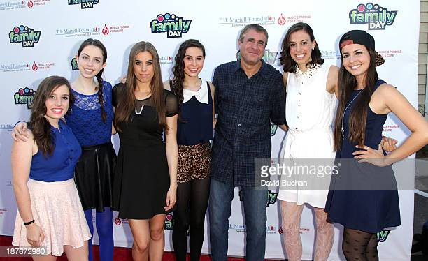 EVP of Ketchum Sounds and Family Day Chairman Marcus Peterzell with girl Band Cimorelli attend at The TJ Martell Foundation's Family Day LA at CBS...